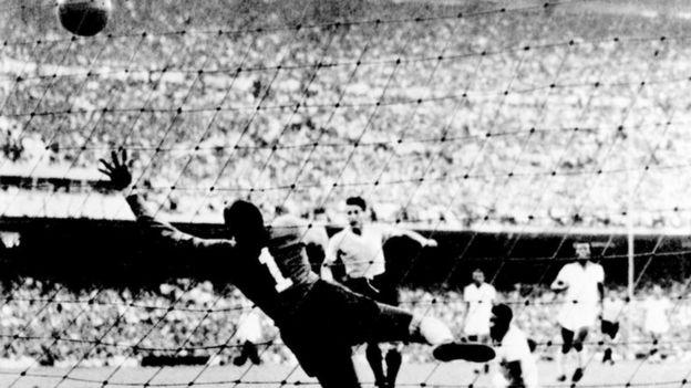 RIO DE JANEIRO, BRAZIL - JULY 16: Uruguayan forward Juan Alberto Schiaffino (C) kicks the ball past Brazilian goalkeeper Moacyr Barbosa to level the score during the World Cup final round soccer match between Uruguay and Brazil 16 July 1950