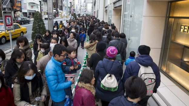 People wait in a queue line for the gate of Matsuya Ginza Department store to purchase a Fukubukuro