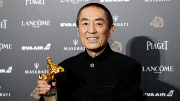 Chinese director Zhang Yimou poses backstage after winning Best Director for his movie Shadow at the 55th Golden Horse Awards in Taipei, Taiwan