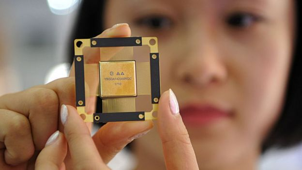 Woman holding 5G computer chip