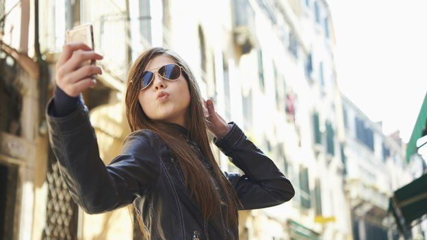 Girl taking a selfie with her mobile phone