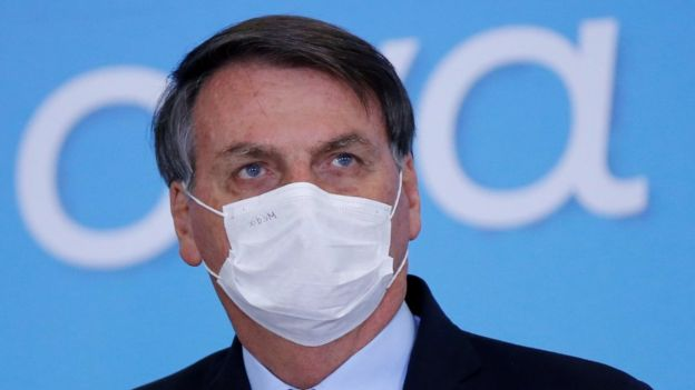 """Brazil""""s President Jair Bolsonaro wearing a protective mask looks on during the launching ceremony of the Plano Safra 2020/2021, an action plan for the agricultural sector, in Brasilia, Brazil, June 17, 2020"""