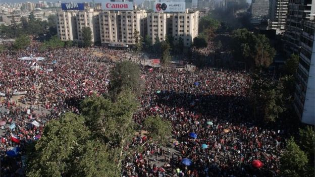 Aerial view as demonstrators march during a national strike and general demonstration called by different workers unions on November 12, 2019 in Santiago, Chile