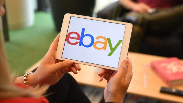 A woman using the eBay app
