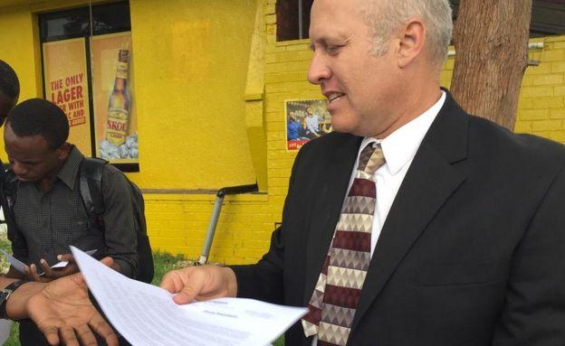 Gregg Schoof talks to reporters in Kigali