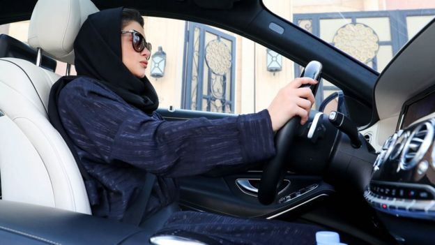 A Saudi woman sat in the driver's seat of a car