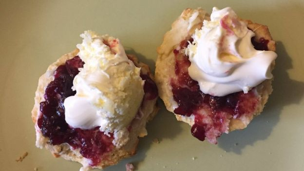 Cream tea with jam on first