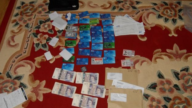 Cash and bank cards laid out on the floor