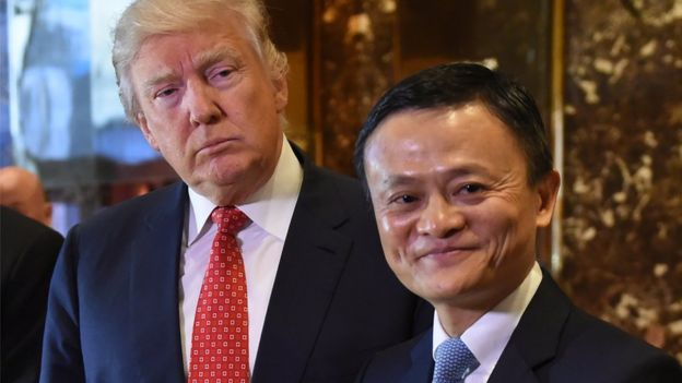 Jack Ma (R) and Donald Trump pose for the media after their meeting at Trump Tower, 9 January 2017