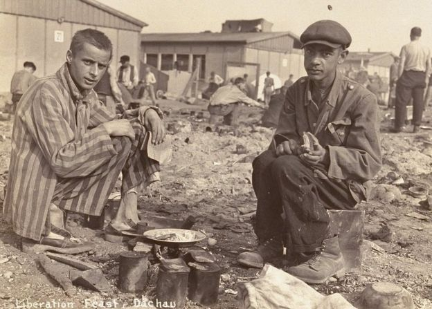 The man on the right in this picture from the Dachau concentration camp is thought to be Jean Voste, born in Congo, who was the only black prisoner in the camp. Courtesy of Frank Manucci.