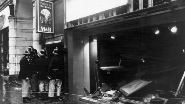 22nd November 1974: Firemen survey the damage outside the Birmingham pub, 'Tavern in the Town', after an IRA bomb blast. (Photo by Wesley/Keystone/Getty Images)