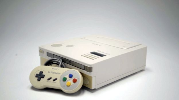 A general view of the Nintendo Playstation and its controller set against a white background