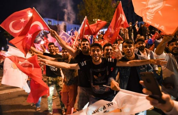 Erdogan supporters celebrate outside the AK party headquarters in Istanbul, Turkey