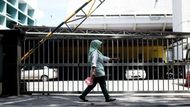 A woman walks past the forensics wing of the Hospital Kuala Lumpur in the Malaysian capital