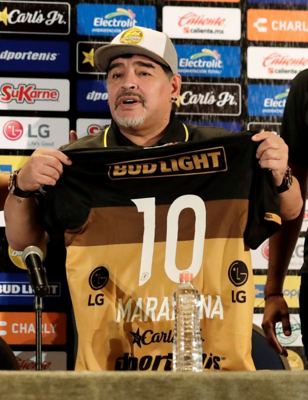 1093e597632 Diego Maradona holds a shirt of the Dorados team with the number 10 on  during a