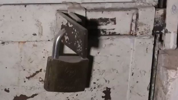 A photograph of a padlocked door in an Islamic State prison in Raqqa