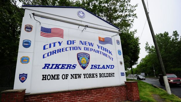 """A sign outside Rikers Island jail, labelling it """"Home of New York's boldest"""""""
