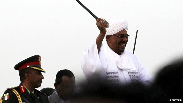 Sudanese President al-Bashir waves to his supporters at the airport in the capital Khartoum