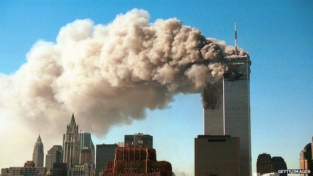 Smoke pours from the World Trade Center after it was hit by two hijacked passenger planes on 11 September 11.
