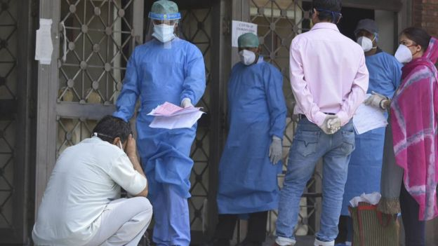 A medical worker brings out a patient report at a Delhi hospital