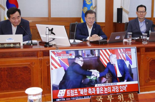 South Korean President Moon Jae-in (C) and Prime Minister Lee Nak-yon (L) watch a television screen showing the summit between US President Donald Trump and North Korean leader Kim Jong Un during a Cabinet meeting at the presidential Blue House in Seoul on June 12, 2018. Donald Trump and Kim Jong Un have become on June 12 the first sitting US and North Korean leaders to meet, shake hands and negotiate to end a decades-old nuclear stand-off. / AFP PHOTO / YONHAP / YONHAP / - South Korea OUT / REPUBLIC OF KOREA OUT NO ARCHIVES RESTRICTED TO SUBSCRIPTION USE YONHAP/AFP/Getty Images