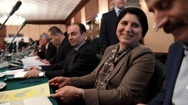Asya Abdullah, leader of the Kurdish Democratic Unity Party (PYD), (centre), smiles as she attends the meeting of Kurdish representatives from Turkey, Syria and Iraq in Moscow on 15 February 2017