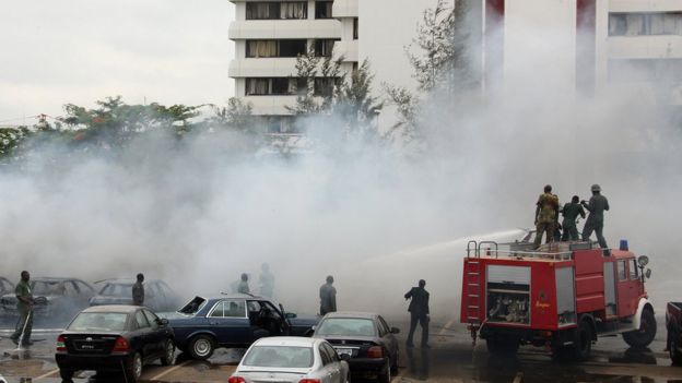 A fire engine at the scene of a bomb at the police HQ in Abuja, Nigeria