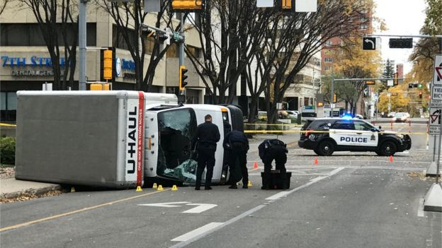 Overturned pictured of u-haul van at scene