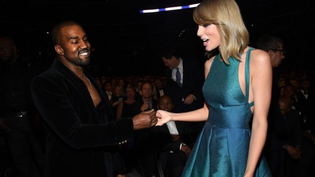 Kanye West and Taylor Swift at a ceremony in 2015