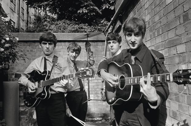 The Beatles in the backyard of the Abbey Road Studios, in London in the early 1960s