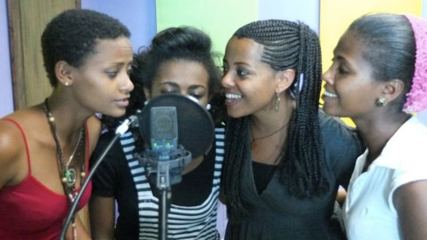Yegna sing into a microphone