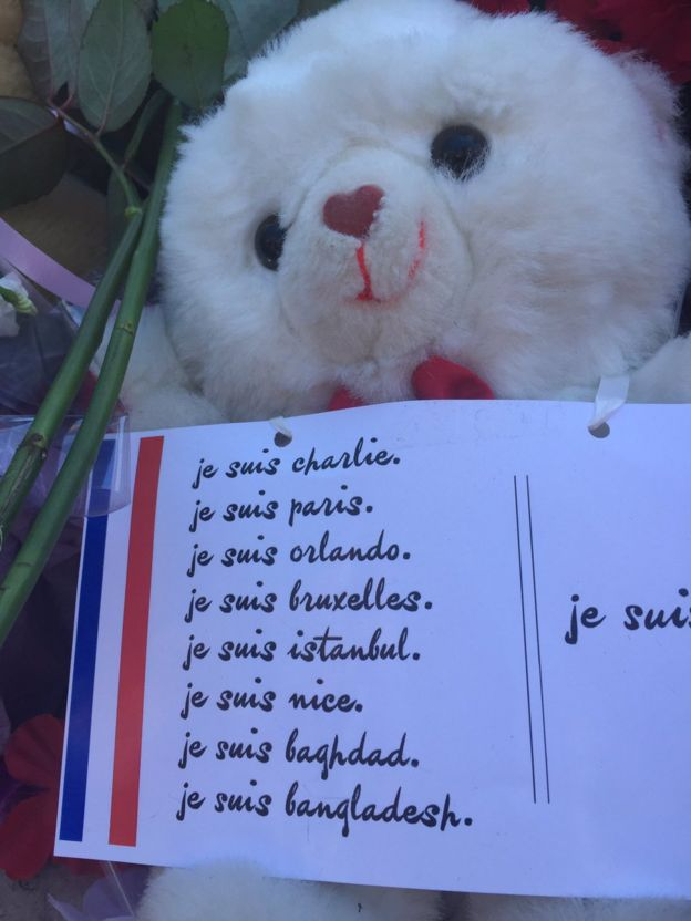 A tribute left by mourners in Nice, France, of a teddy bear holding a sign of solidarity