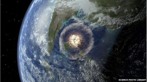 Computer artwork of a large asteroid hitting Earth 65 million years ago.