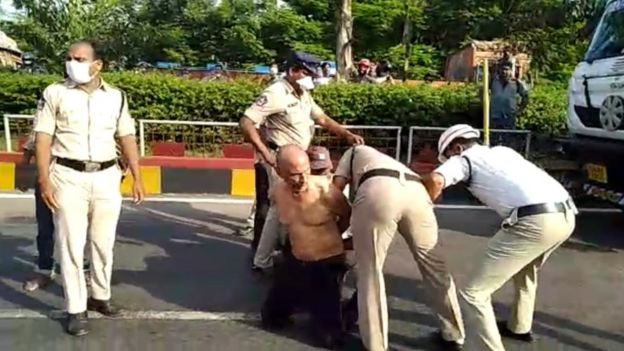 The doctor's hands being tied by the police