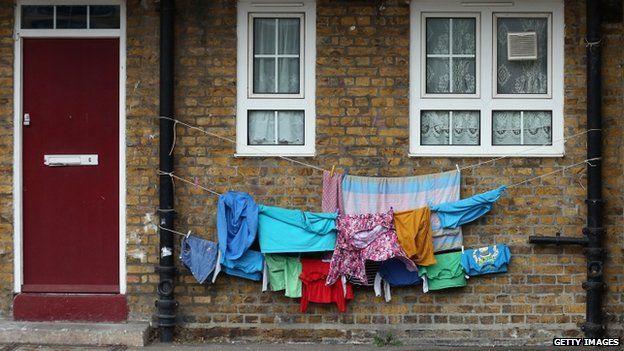 Washing hanging outside a house