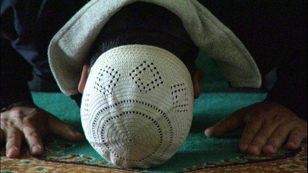Muslim praying in Birmingham
