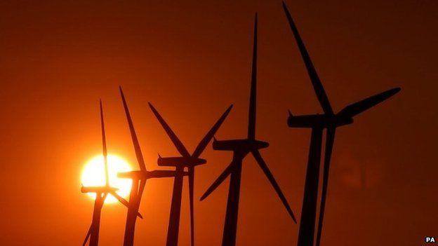 Sun setting over wind turbines