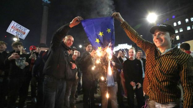 Pro-Brexit supporters burn a EU flag near to Trafalgar Square