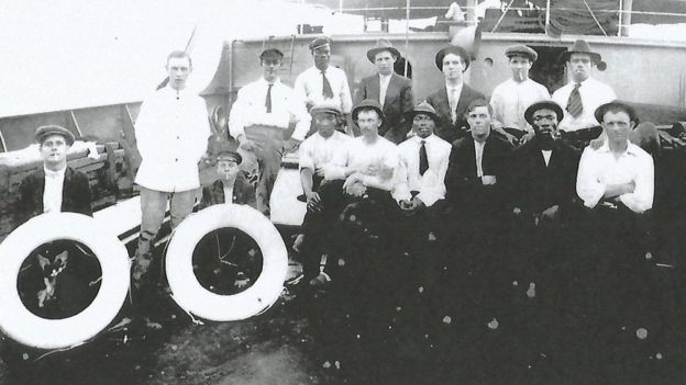 A crew aboard a merchant navy ship