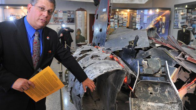 Gary Powers Jnr. with the wreckage of his father's U-2 plane in Moscow
