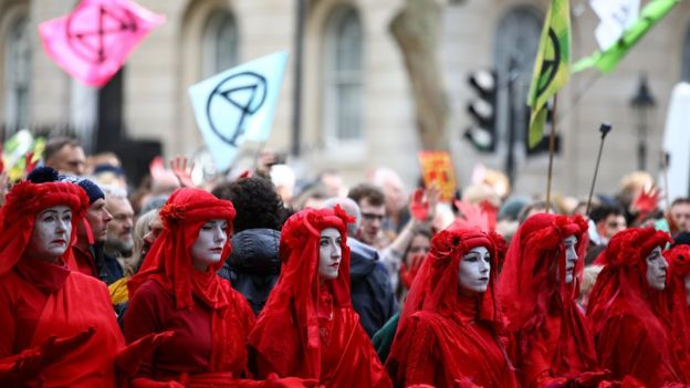 Activists protest during an Extinction Rebellion demonstration in Whitehall, London, on 18 October, 2019.