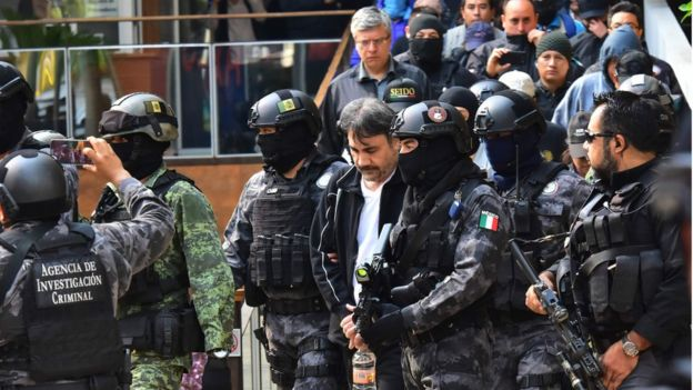Damaso Lopez surrounded by police after his arrest in May