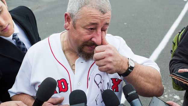 A tearful former Ford employee speaks to reporters after a factory closure last year