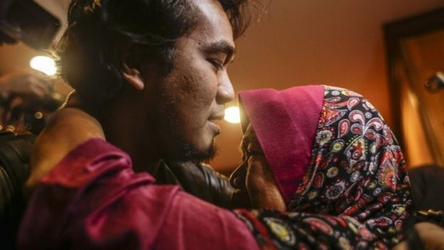 Mohd Radzuan Othman (L), one of the nine returning Malaysian nationals hugs his mother upon arriving at the Bunga Raya complex, Kuala Lumpur International airport in Sepang, Malaysia, 31 March 2017.