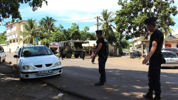 Gendarmes control the road traffic and check IDs on 15 March 2018 in Majicavo in the French overseas territory of Mayotte