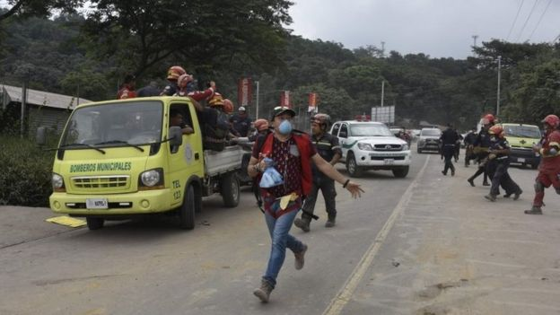 Rescuers running near El Rodeo