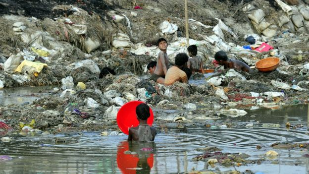 Indian men search for coins and gold in the polluted waters of the Ganga river at Sangam after the Kumbh Mela festival, in Allahabad on April 2, 2013.