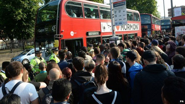 Commuters queue for buses during London tube strike