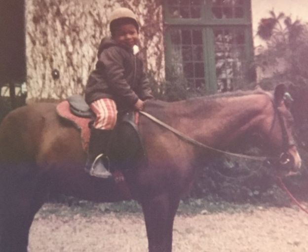 Dionne Draper as a child on a horse.