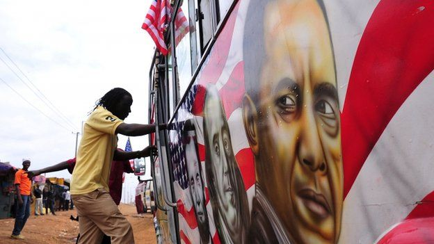 """Man boards a """"matatu"""" minibus with a painting depicting US Presidents Abraham Lincoln and Barack Obama and US scientist Benjamin Franklin"""